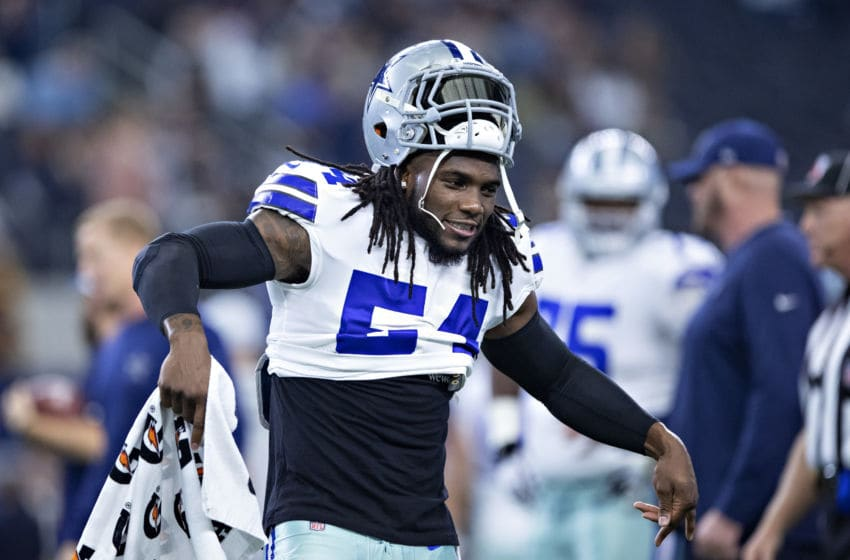 ARLINGTON, TX - NOVEMBER 22: Jaylon Smith #54 of the Dallas Cowboys warms up with a dance before a game against the Washington Redskins at AT&T Stadium on November 22, 2018 in Arlington, Texas. The Cowboys defeated the Redskins 31-23. (Photo by Wesley Hitt/Getty Images)