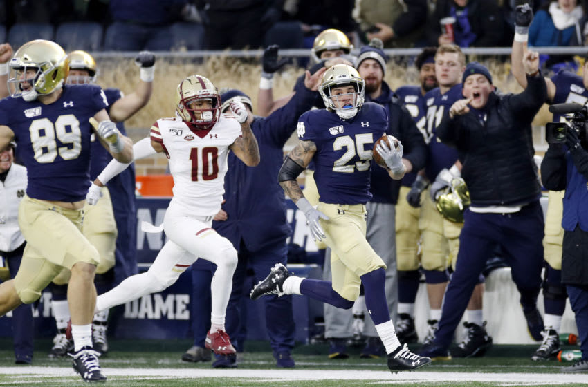 SOUTH BEND, IN - NOVEMBER 23: Braden Lenzy #25 of the Notre Dame Fighting Irish runs downfield for 61-yard touchdown ahead of Brandon Sebastian #10 of the Boston College Eagles during a game at Notre Dame Stadium on November 23, 2019 in South Bend, Indiana. Notre Dame defeated Boston College 40-7. (Photo by Joe Robbins/Getty Images)