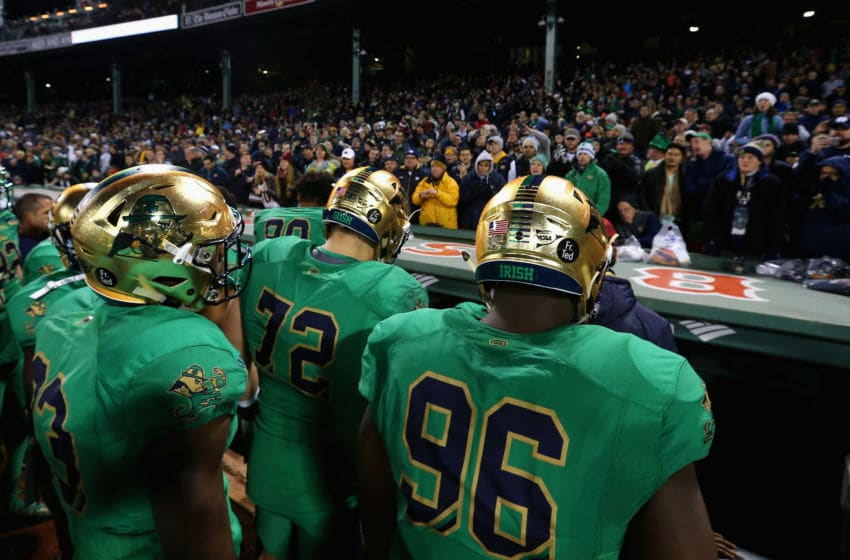 BOSTON, MA - NOVEMBER 21: Pete Mokwuah #96 of the Notre Dame Fighting Irish and Nick Martin #72 enter the locker room after their game against the Boston College Eagles at Fenway Park on November 21, 2015 in Boston, Massachusetts. (Photo by Maddie Meyer/Getty Images)