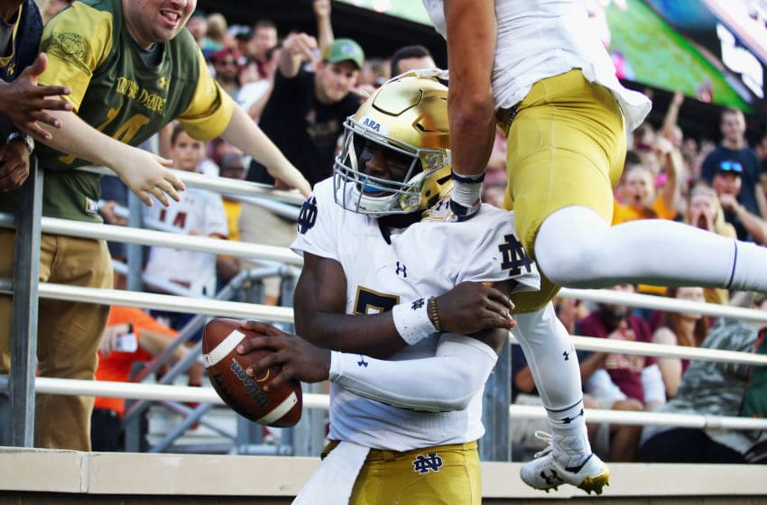 CHESTNUT HILL, MA - SEPTEMBER 16: Brandon Wimbush #7 of the Notre Dame Fighting Irish celebrates after rushing for a 65-yard touchdown during the fourth quarter against the Boston College Eagles at Alumni Stadium on September 16, 2017 in Chestnut Hill, Massachusetts. (Photo by Tim Bradbury/Getty Images)