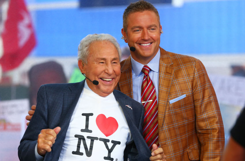 NEW YORK, NY - SEPTEMBER 23: ESPN's College GameDay Analysts Lee Corso and Kirk Herbstreit, pose for a photo during ESPN's College GameDay show at Times Square on September 23, 2017 in New York City. (Photo by Mike Stobe/Getty Images)