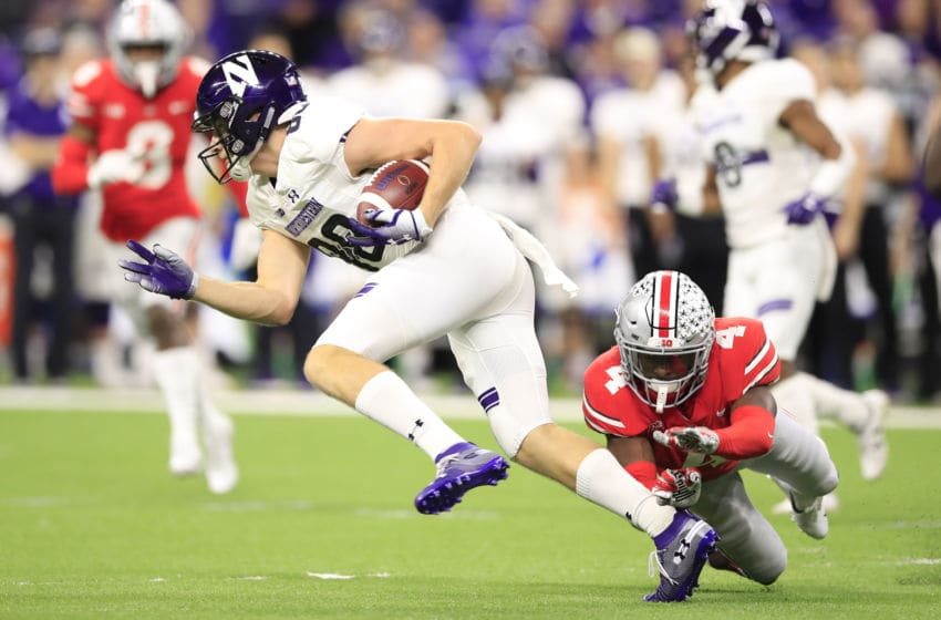 INDIANAPOLIS, INDIANA - DECEMBER 01: Bennett Skowronek #88 of the Northwestern Wildcats escapes a tackle from Jordan Fuller #4 of the Ohio State Buckeyes in the second quarter at Lucas Oil Stadium on December 01, 2018 in Indianapolis, Indiana. (Photo by Andy Lyons/Getty Images)