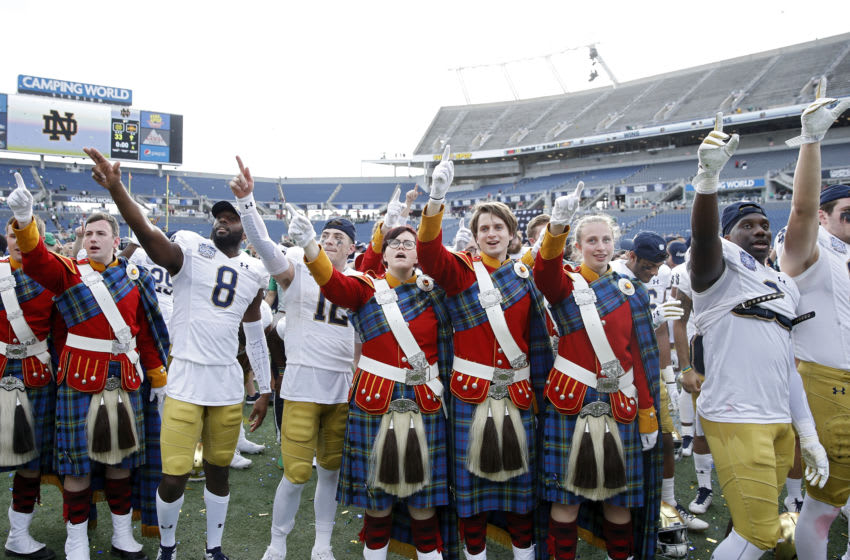 ORLANDO, FL - DECEMBER 28: Notre Dame Fighting Irish celebrate with the band following the Camping World Bowl against the Iowa State Cyclones at Camping World Stadium on December 28, 2019 in Orlando, Florida. Notre Dame defeated Iowa State 33-9. (Photo by Joe Robbins/Getty Images)