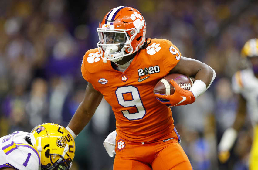 NEW ORLEANS, LOUISIANA - JANUARY 13: Travis Etienne #9 of the Clemson Tigers runs the ball against Derion Kendrick #1 of the Clemson Tigers during the first quarter in the College Football Playoff National Championship game at Mercedes Benz Superdome on January 13, 2020 in New Orleans, Louisiana. (Photo by Kevin C. Cox/Getty Images)