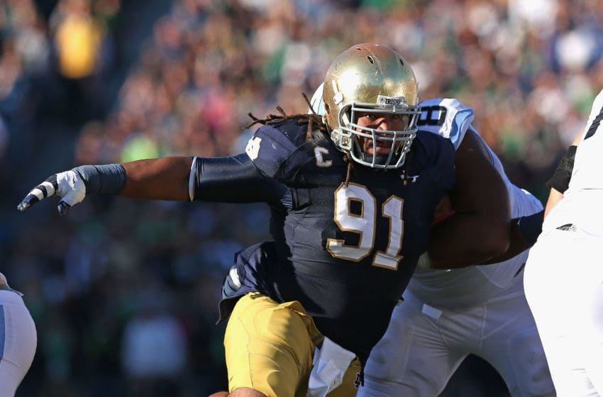 SOUTH BEND, IN - OCTOBER 11: Sheldon Day #91 of the Notre Dame Fighting Irish rushes past Landon Turner #78 of the North Carolina Tar Heels at Notre Dame Stadium on October 11, 2014 in South Bend, Indiana. (Photo by Jonathan Daniel/Getty Images)