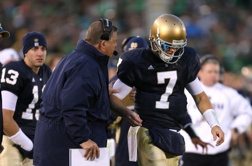 SOUTH BEND, IN - OCTOBER 17: Head coach Charlie Weis of the Notre Dame Fighting Irish gives a play to quarterback Jimmy Clausen #7 during a game against the USC Trojans at Notre Dame Stadium on October 17, 2009 in South Bend, Indiana. USC defeated Notre Dame 34-27. (Photo by Jonathan Daniel/Getty Images)