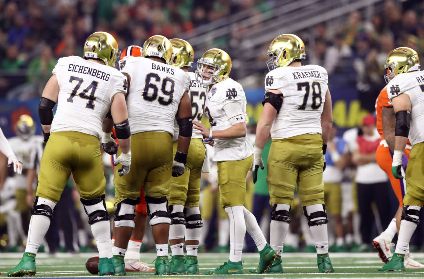 ARLINGTON, TEXAS - DECEMBER 29: Ian Book #12 of the Notre Dame Fighting Irish speaks to his line in the first half against the Clemson Tigers during the College Football Playoff Semifinal Goodyear Cotton Bowl Classic at AT&T Stadium on December 29, 2018 in Arlington, Texas. (Photo by Ronald Martinez/Getty Images)