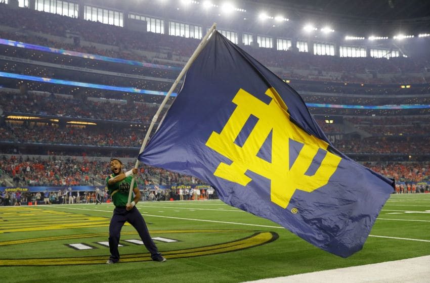 ARLINGTON, TEXAS - DECEMBER 29: A Notre Dame Fighting Irish cheerleader waves a flag during the College Football Playoff Semifinal Goodyear Cotton Bowl Classic against the Clemson Tigers at AT&T Stadium on December 29, 2018 in Arlington, Texas. (Photo by Kevin C. Cox/Getty Images)