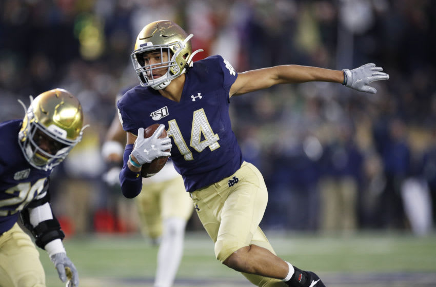 SOUTH BEND, IN - NOVEMBER 23: Kyle Hamilton #14 of the Notre Dame Fighting Irish runs with the ball after an interception during a game against the Boston College Eagles at Notre Dame Stadium on November 23, 2019 in South Bend, Indiana. Notre Dame defeated Boston College 40-7. (Photo by Joe Robbins/Getty Images)