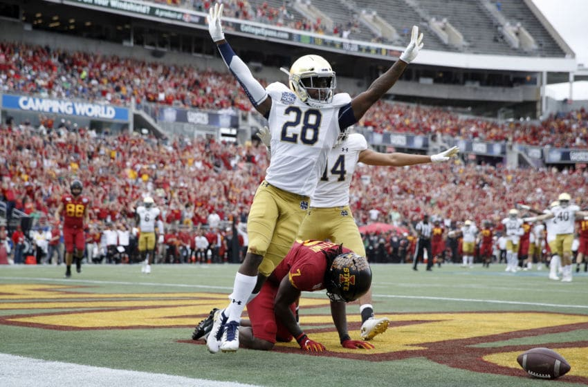 ORLANDO, FL - DECEMBER 28: TaRiq Bracy #28 of the Notre Dame Fighting Irish celebrates after breaking up a pass in the end zone during the Camping World Bowl against the Iowa State Cyclones at Camping World Stadium on December 28, 2019 in Orlando, Florida. Notre Dame defeated Iowa State 33-9. (Photo by Joe Robbins/Getty Images)