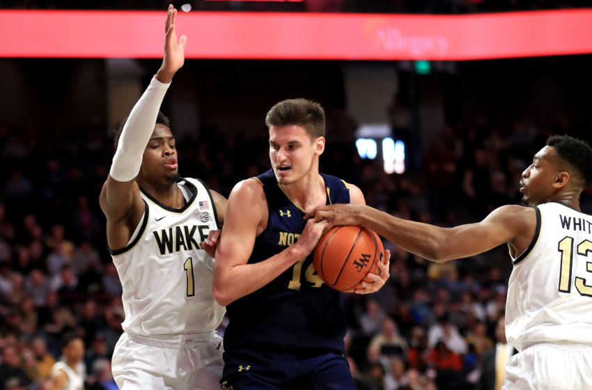 WINSTON-SALEM, NORTH CAROLINA - FEBRUARY 29: Teammates Isaiah Mucius #1 and Andrien White #13 of the Wake Forest Demon Deacons try to stop Nate Laszewski #14 of the Notre Dame Fighting Irish during their game at LJVM Coliseum Complex on February 29, 2020 in Winston-Salem, North Carolina. (Photo by Streeter Lecka/Getty Images)