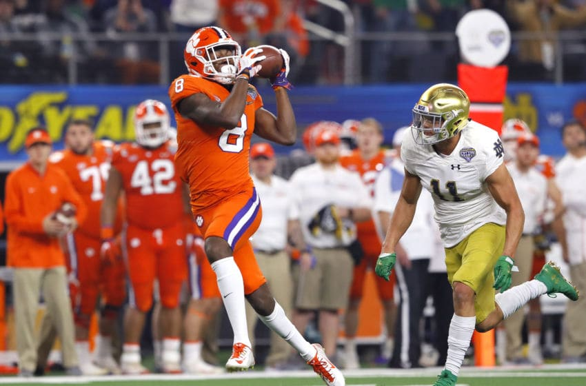ARLINGTON, TEXAS - DECEMBER 29: Justyn Ross #8 of the Clemson Tigers catches a pass for a 42 yard touchdown catch in the second quarter against Alohi Gilman #11 of the Notre Dame Fighting Irish during the College Football Playoff Semifinal Goodyear Cotton Bowl Classic at AT&T Stadium on December 29, 2018 in Arlington, Texas. (Photo by Kevin C. Cox/Getty Images)