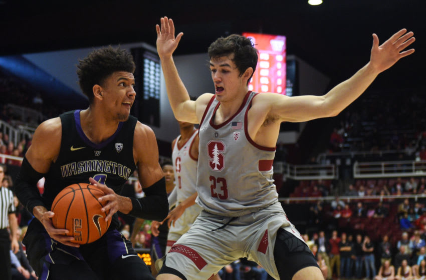 PALO ALTO, CA - MARCH 03: Matisse Thybulle #4 of the Washington Huskies drives on Cormac Ryan #23 of the Stanford Cardinal during their game at Maples Pavilion on March 3, 2019 in Palo Alto, California. (Photo by Cody Glenn/Getty Images)