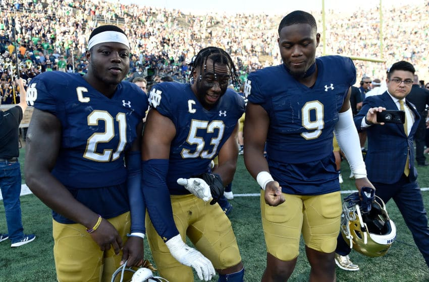 SOUTH BEND, INDIANA - SEPTEMBER 14: Jalen Elliott #21, Khalid Kareem, and Daelin Hayes #9 of the Notre Dame Fighting Irish pose to celebrate the victory against the New Mexico Lobos at Notre Dame Stadium on September 14, 2019 in South Bend, Indiana. (Photo by Quinn Harris/Getty Images)