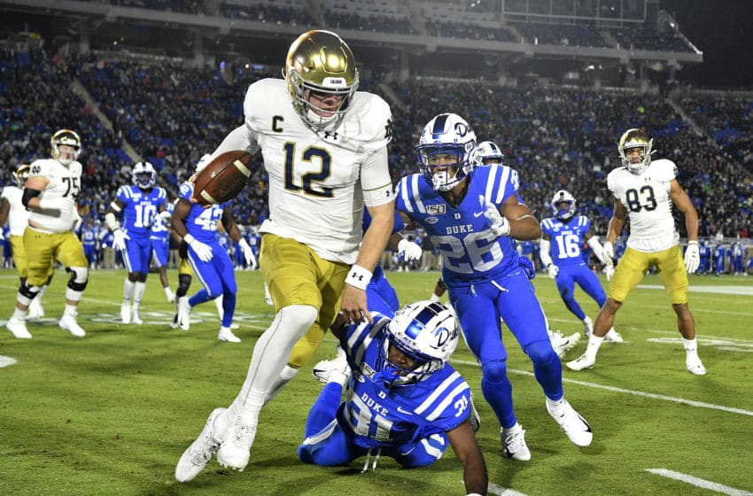 DURHAM, NORTH CAROLINA - NOVEMBER 09: Josh Blackwell #31 and Michael Carter II #26 of the Duke Blue Devils chase Ian Book #12 of the Notre Dame Fighting Irish out of bounds during the first quarter of their game at Wallace Wade Stadium on November 09, 2019 in Durham, North Carolina. (Photo by Grant Halverson/Getty Images)