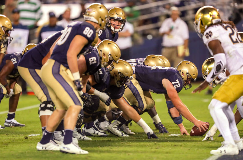 SAN DIEGO, CA - OCTOBER 27: Ford Higgins #72 of the Navy Midshipmen prepares to hike the ball to Zach Abey #9 in the 2nd half against the Notre Dame Fighting Irish at SDCCU Stadium on October 27, 2018 in San Diego, California. (Photo by Kent Horner/Getty Images)
