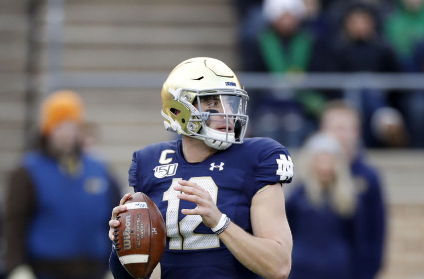 SOUTH BEND, IN - NOVEMBER 23: Ian Book #12 of the Notre Dame Fighting Irish looks to pass the ball during a game against the Boston College Eagles at Notre Dame Stadium on November 23, 2019 in South Bend, Indiana. Notre Dame defeated Boston College 40-7. (Photo by Joe Robbins/Getty Images)