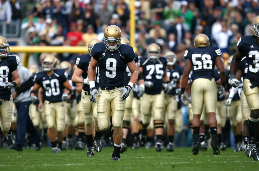 SOUTH BEND, IN - OCTOBER 03: Kyle Rudolph #9 of the Notre Dame Fighting Irish runs onto the field with teammates before a game against the Washington Huskies on October 3, 2009 at Notre Dame Stadium in South Bend, Indiana. Notre Dame defeated Washington 37-30 in overtime. (Photo by Jonathan Daniel/Getty Images)