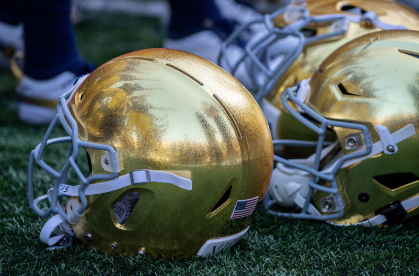 Sep 14, 2019; South Bend, IN, USA; The Notre Dame Fighting Irish are reflected in a helmet as they sing the Notre Dame Alma Mater following the win over the New Mexico Lobos at Notre Dame Stadium. Mandatory Credit: Matt Cashore-USA TODAY Sports