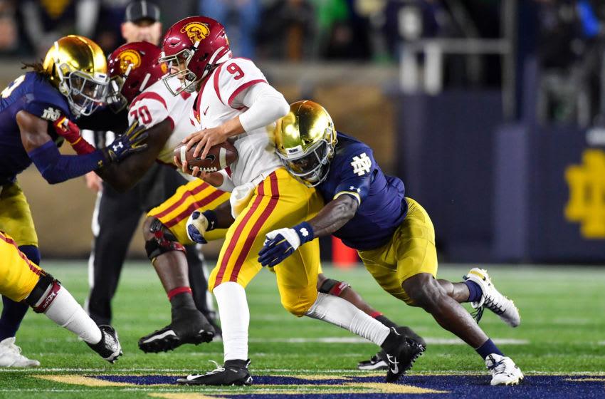 Oct 12, 2019; South Bend, IN, USA; USC Trojans quarterback Kedon Slovis (9) is sacked by Notre Dame Fighting Irish defensive back Jeremiah Owusu-Koramoah (6) in the first quarter at Notre Dame Stadium. Mandatory Credit: Matt Cashore-USA TODAY Sports