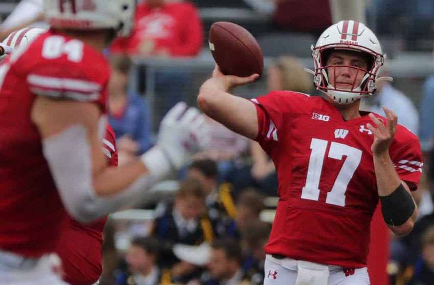 Wisconsin quarterback Jack Coan (17) thows a pass to tight end Jake Ferguson during the third quarter of their game Saturday, September 7, 2019 at Camp Randall in Madison, Wis. Wisconsin beat Central Michigan 61-0. Mjs Uwgrid08 58 Hoffman Jpg Uwgrid08