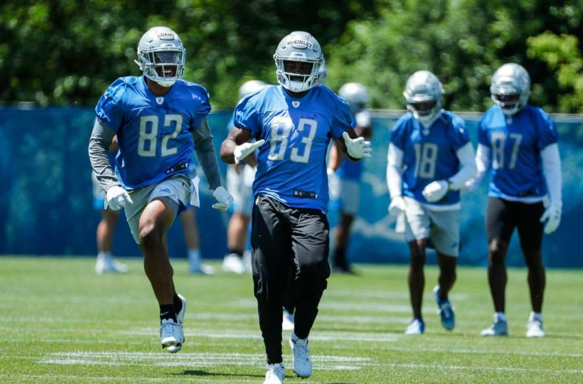 Detroit Lions receivers Jonathan Adams (82) and Javon McKinley (83) during organized team activities at Lions headquarters in Allen Park, Thursday, May 27, 2021.