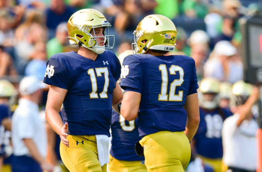 Sep 11, 2021; South Bend, Indiana, USA; Notre Dame Fighting Irish quarterback Jack Coan (17) runs on to the field as quarterback Tyler Buchner (12) leaves the field in the third quarter at Notre Dame Stadium. Mandatory Credit: Matt Cashore-USA TODAY Sports