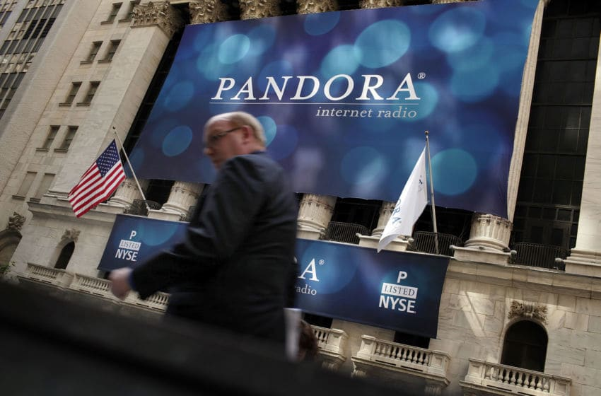 NEW YORK, NY - JUNE 15: A banner for Pandora Media Inc., the online-radio company, hangs in front of the New York Stock Exchange walk on its first day of trading as a public company on June 15, 2011 in New York City. Pandora stock rose as much as 63 percent to $26 following its debut on the New York Stock Exchange, under the symbol P. Reversing much of the previous day's gains, stocks fell Wednesday as more news emerged about the fragility of the American and global economy. The Dow Jones Industrial Average fell 88 points, or 0.8%, to 11987 in morning trading. (Photo by Spencer Platt/Getty Images)