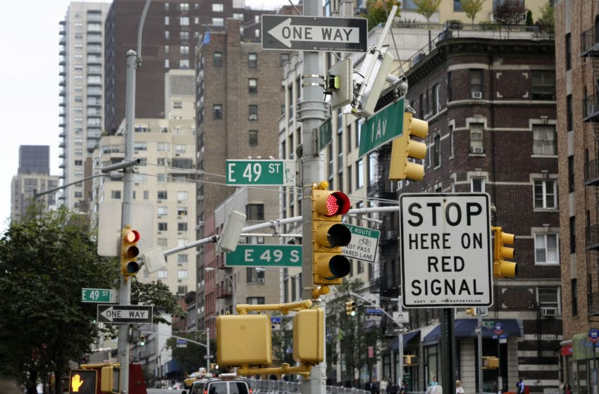 NEW YORK CITY, UNITED STATES - SEPTEMBER 24: Street signs and traffic lights on an intersection in downtown Manhattan on September 24, 2014, in New York City, United States. Photo by Thomas Koehler/Photothek via Getty Images)***Local Caption***