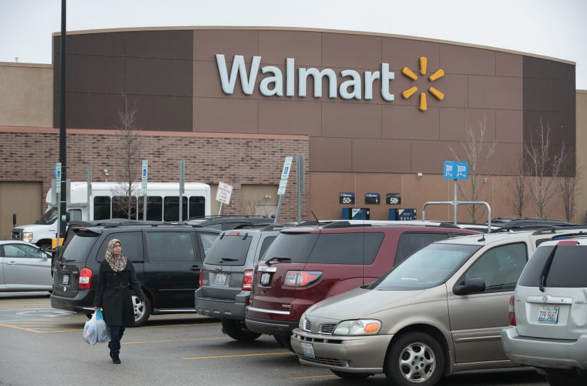 SKOKIE, IL - JANUARY 17: Customers shop at a Walmart store on January 17, 2017 in Skokie, Illinois. Wal-Mart Stores Inc., the nation's largest employer, announced today that it plans to create approximately 10,000 retail jobs this year through the opening of 59 new, expanded and relocated Walmart and Sams Club facilities and e-commerce services. (Photo by Scott Olson/Getty Images)