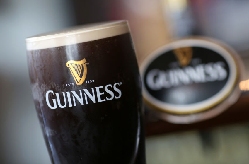 A branded pint of Guinness stout sits on the bar at The Honor Oak public house, operated by Punch Taverns Plc, in London, U.K., on Wednesday, Sept. 2, 2015. Punch Taverns owns leased and tenanted pubs in the United Kingdom. Photographer: Chris Ratcliffe/Bloomberg via Getty Images