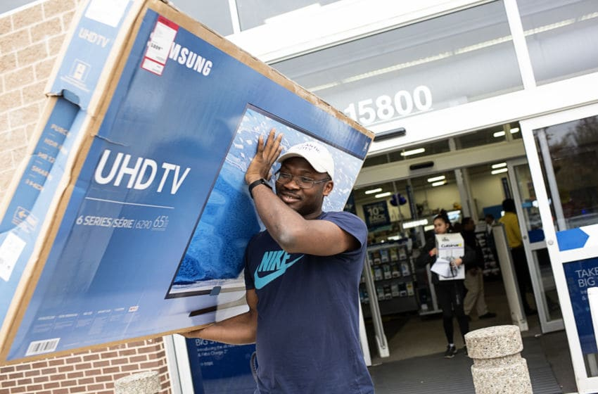 BOWIE, MD - NOVEMBER 25: Ade Ibironke purchases a large television as several Black Friday shoppers take advantage of low sales prices at Best Buy in Bowie, Maryland on November, 25, 2016 (Photo by Marvin Joseph/The Washington Post via Getty Images)