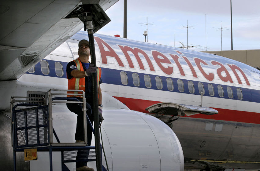 PHOENIX - NOVEMBER 15: American Airlines fueler, John Perrone, watches the gauges during refueling of an American Airlines jet at Phoenix Sky Harbor International Airport November 15, 2004 in Phoenix, Arizona. More than one million gallons of jet fuel are dispensed every day at this airport. (Photo by Jeff Topping/Getty Images)
