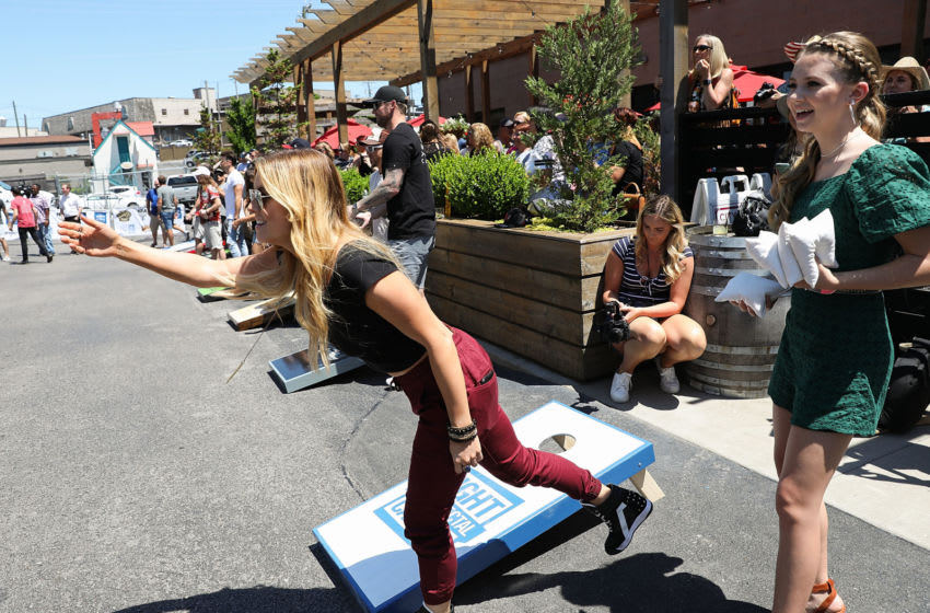 NASHVILLE, TN - JUNE 05: Lindsay Ell (L) and Tegan Marie (R) compete at Craig Campbell's 6th Annual Celebrity Cornhole Challenge at City Winery Nashville on June 5, 2018 in Nashville, Tennessee. (Photo by Leah Puttkammer/Getty Images)