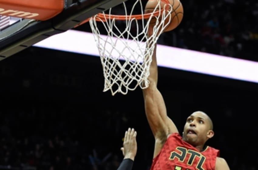 Jan 18, 2016; Atlanta, GA, USA; Atlanta Hawks center Al Horford (15) dunks the ball over Orlando Magic forward Tobias Harris (12) during the second half at Philips Arena. The Hawks defeated the Magic 98-81. Mandatory Credit: Dale Zanine-USA TODAY Sports
