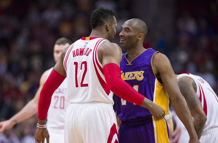 Apr 10, 2016; Houston, TX, USA; Houston Rockets center Dwight Howard (12) and Los Angeles Lakers forward Kobe Bryant (24) meet at center court before the game at the Toyota Center. Mandatory Credit: Jerome Miron-USA TODAY Sports