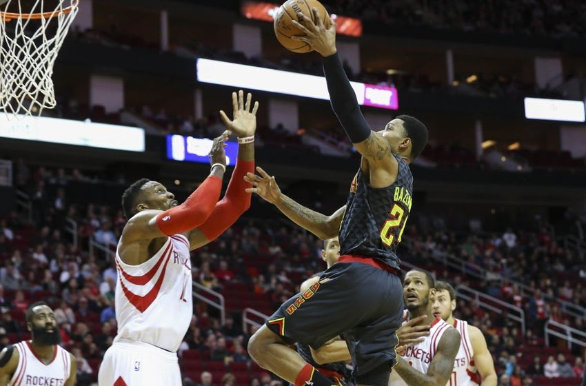 Dec 29, 2015; Houston, TX, USA; Atlanta Hawks forward Kent Bazemore (24) moves the ball over Houston Rockets center Dwight Howard (12) during the first quarter at Toyota Center. Mandatory Credit: Troy Taormina-USA TODAY Sports