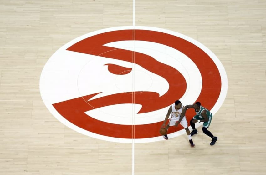 Apr 19, 2016; Atlanta, GA, USA; Atlanta Hawks guard Jeff Teague (0) is guarded against Boston Celtics guard Terry Rozier (12) near the Atlanta Hawks logo in the fourth quarter of game two of the first round of the NBA Playoffs at Philips Arena. The Hawks won 89-72. Mandatory Credit: Jason Getz-USA TODAY Sports