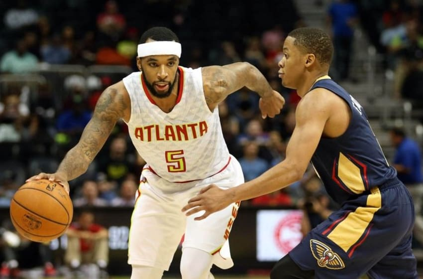 Oct 18, 2016; Atlanta, GA, USA; Atlanta Hawks guard Malcolm Delaney (5) drives against New Orleans Pelicans guard Tim Frazier (2) in the third quarter of their game at Philips Arena. The Hawks won 96-89. Mandatory Credit: Jason Getz-USA TODAY Sports