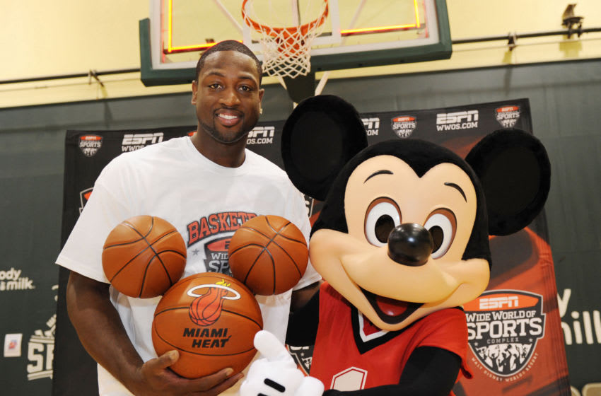 LAKE BUENA VISTA, FL - JULY 11: In this handout image provided by Walt Disney Studios, Miami Heat guard Dwyane Wade poses July 11, 2010 with a basketball-clad Mickey Mouse at the ESPN Wide World of Sports complex in Lake Buena Vista, Fla. In honor of Wade's visit to the 220-acre sports facility, Walt Disney World presented him with a custom-made and hand-painted trio of basketballs in the shape of Mickey Mouse's head. The Disney World visit ended a week which saw Wade re-sign with the Miami Heat, where he will be joined next season by newly signed stars LeBron James and Chris Bosh. (Photo by Todd Anderson / Disney via Getty Images)