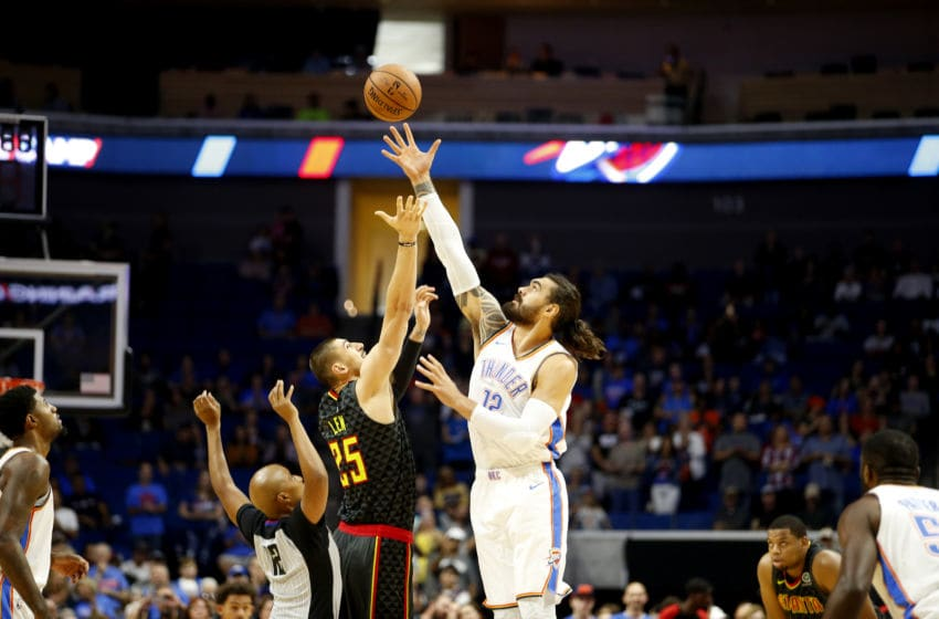 TULSA, OK - OCTOBER 7: Steven Adams #12 of the Oklahoma City Thunder and Alex Len #25 of the Atlanta Hawks jump for tip-off during a pre-season game on October 7, 2018 at BOK Center, in Tulsa, Oklahoma. NOTE TO USER: User expressly acknowledges and agrees that, by downloading and/or using this Photograph, user is consenting to the terms and conditions of the Getty Images License Agreement. Mandatory Copyright Notice: Copyright 2018 NBAE (Photo by Shane Bevel/NBAE via Getty Images)