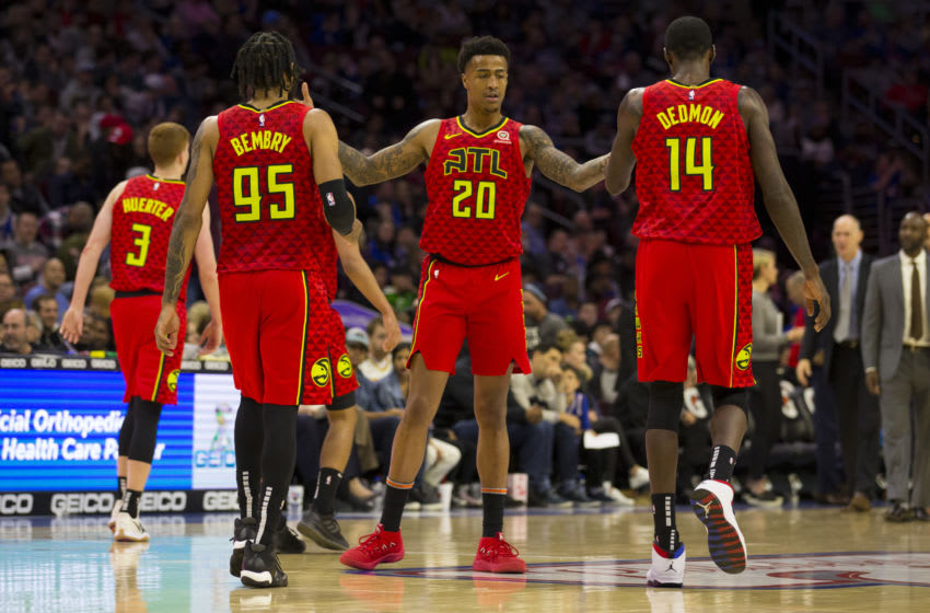 PHILADELPHIA, PA - JANUARY 11: Kevin Huerter #3, DeAndre' Bembry #95, John Collins #20, and Dewayne Dedmon #14 of the Atlanta Hawks react against the Philadelphia 76ers at the Wells Fargo Center on January 11, 2019 in Philadelphia, Pennsylvania. The Hawks defeated the 76ers 123-121. NOTE TO USER: User expressly acknowledges and agrees that, by downloading and or using this photograph, User is consenting to the terms and conditions of the Getty Images License Agreement. (Photo by Mitchell Leff/Getty Images)