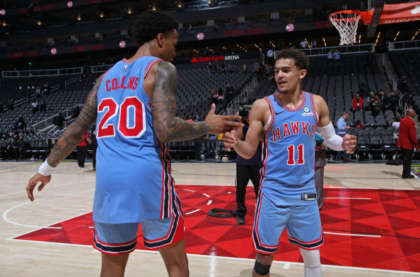 John Collins #20 and Trae Young #11 of the Atlanta Hawks (Copyright 2019 NBAE (Photo by Jasear Thompson/NBAE via Getty Images)