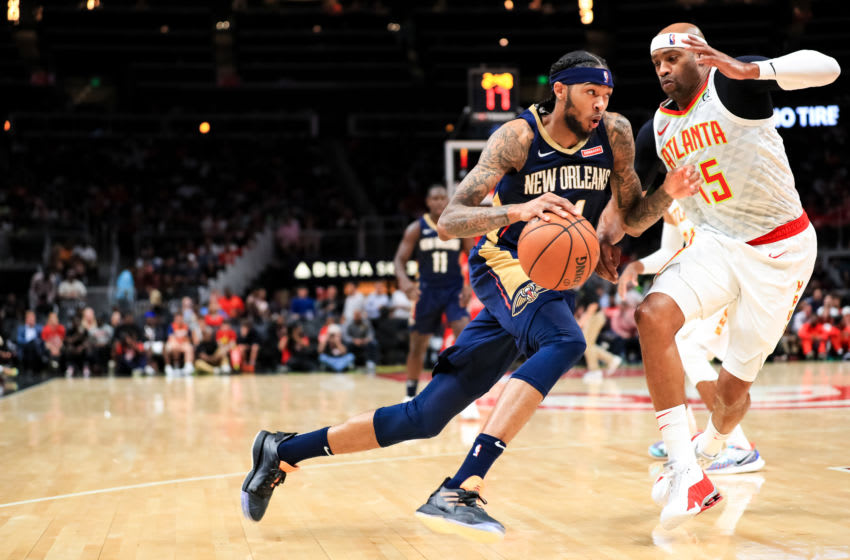 ATLANTA, GA - OCTOBER 7: Brandon Ingram #14 of the New Orleans Pelicans drives to the net around Vince Carter #15 of the Atlanta Hawks during a preseason game at State Farm Arena on October 7, 2019 in Atlanta, Georgia. NOTE TO USER: User expressly acknowledges and agrees that, by downloading and or using this photograph, User is consenting to the terms and conditions of the Getty Images License Agreement. (Photo by Carmen Mandato/Getty Images)