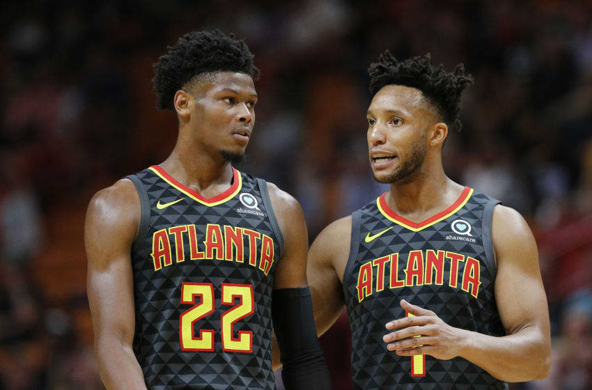 MIAMI, FLORIDA - OCTOBER 14: Cam Reddish #22 of the Atlanta Hawks talks with Evan Turner #1 against the Miami Heat during the first half of the preseason game at American Airlines Arena on October 14, 2019 in Miami, Florida. NOTE TO USER: User expressly acknowledges and agrees that, by downloading and or using this photograph, User is consenting to the terms and conditions of the Getty Images License Agreement. (Photo by Michael Reaves/Getty Images)