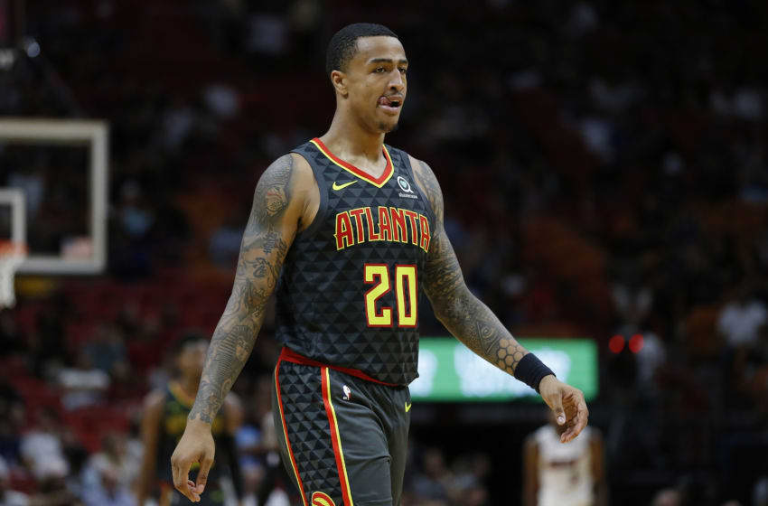 MIAMI, FLORIDA - OCTOBER 14: John Collins #20 of the Atlanta Hawks looks on against the Miami Heat during the second half of the preseason game at American Airlines Arena on October 14, 2019 in Miami, Florida. NOTE TO USER: User expressly acknowledges and agrees that, by downloading and or using this photograph, User is consenting to the terms and conditions of the Getty Images License Agreement. (Photo by Michael Reaves/Getty Images)