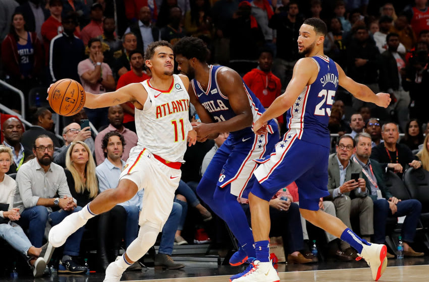 ATLANTA, GEORGIA - OCTOBER 28: Trae Young #11 of the Atlanta Hawks draws a foul from Joel Embiid #21 of the Philadelphia 76ers in the final seconds of second half at State Farm Arena on October 28, 2019 in Atlanta, Georgia. NOTE TO USER: User expressly acknowledges and agrees that, by downloading and/or using this photograph, user is consenting to the terms and conditions of the Getty Images License Agreement. (Photo by Kevin C. Cox/Getty Images)