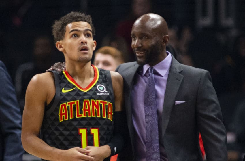 ATLANTA, GA - NOVEMBER 25: Trae Young #11 and head coach Lloyd Pierce of the Atlanta Hawks talk during the first quarter against the Minnesota Timberwolves at State Farm Arena on November 25, 2019 in Atlanta, Georgia. NOTE TO USER: User expressly acknowledges and agrees that, by downloading and or using this photograph, User is consenting to the terms and conditions of the Getty Images License Agreement. (Photo by Carmen Mandato/Getty Images)