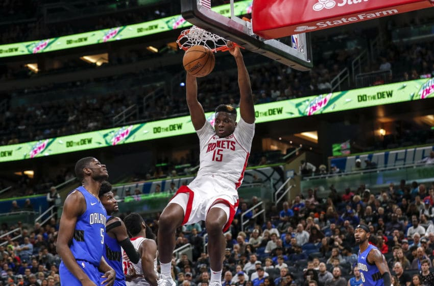 ORLANDO, FL - DECEMBER 13: Clint Capela #15 of the Houston Rockets goes up for a dunk over Mo Bamba #5 and Jonathan Isaac #1 of the Orlando Magic during the game at the Amway Center on December 13, 2019 in Orlando, Florida. The Rockets defeated the Magic 130 to 107. NOTE TO USER: User expressly acknowledges and agrees that, by downloading and or using this photograph, User is consenting to the terms and conditions of the Getty Images License Agreement. (Photo by Don Juan Moore/Getty Images)