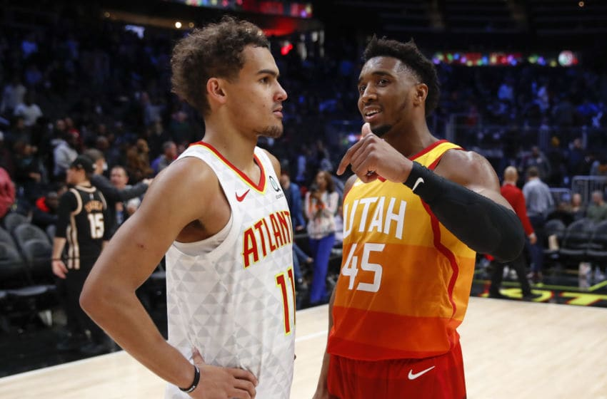 ATLANTA, GA - DECEMBER 19: Donovan Mitchell #45 of the Utah Jazz speaks with Trae Young #11 of the Atlanta Hawks at the conclusion of an NBA game at State Farm Arena on December 19, 2019 in Atlanta, Georgia. NOTE TO USER: User expressly acknowledges and agrees that, by downloading and/or using this photograph, user is consenting to the terms and conditions of the Getty Images License Agreement. (Photo by Todd Kirkland/Getty Images)